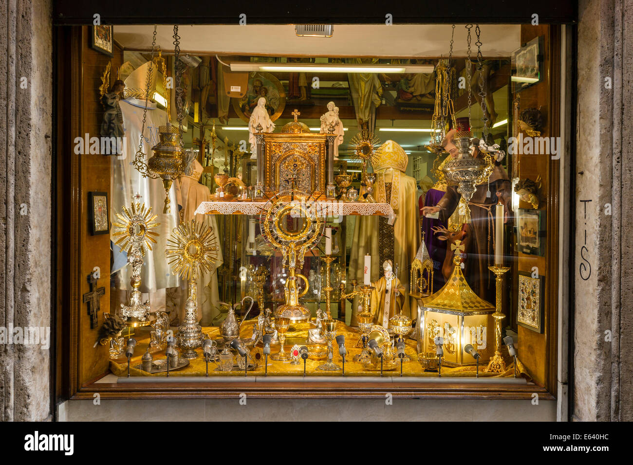 Shop window with devotional objects and goods for priests, Rome, Lazio, Italy - Stock Image