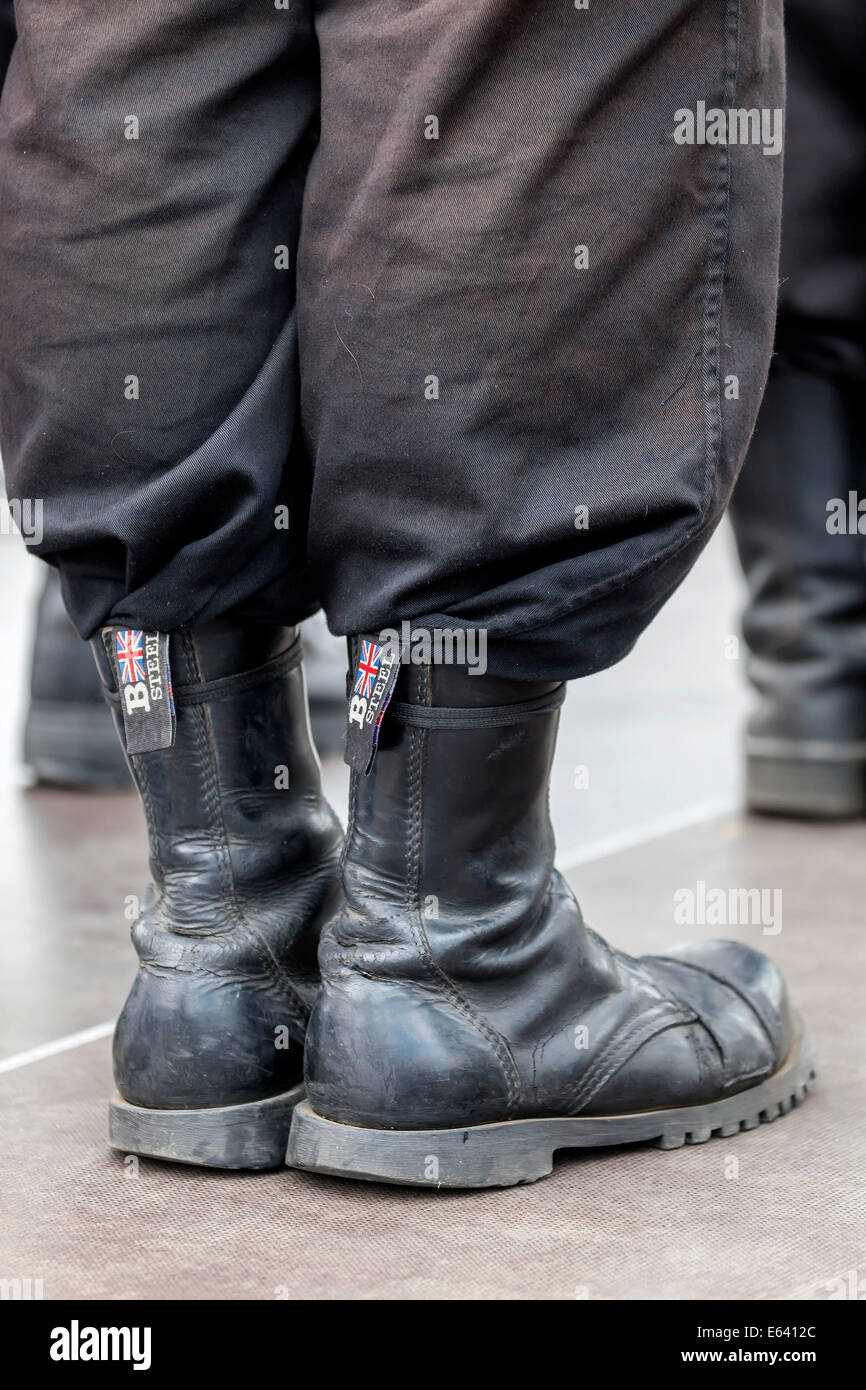 Member of a right-wing Hungarian party wearing combat boots, symbolic image for right-wing extremism, Budapest, - Stock Image