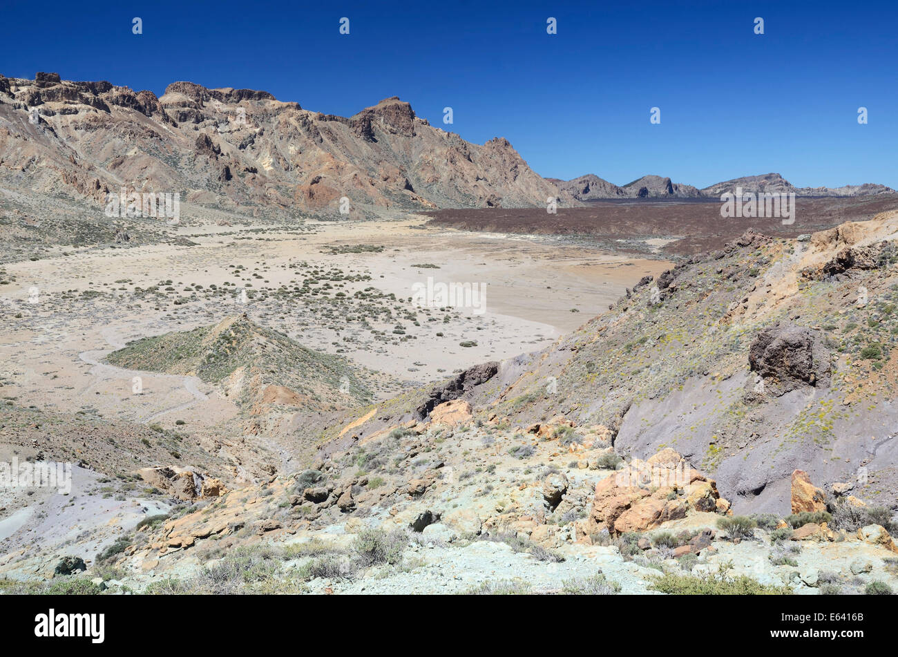 Collapse crater or caldera with lava fields in the Llano de Ucanca, with blue 'Los Azulejos' lava and macchia - Stock Image