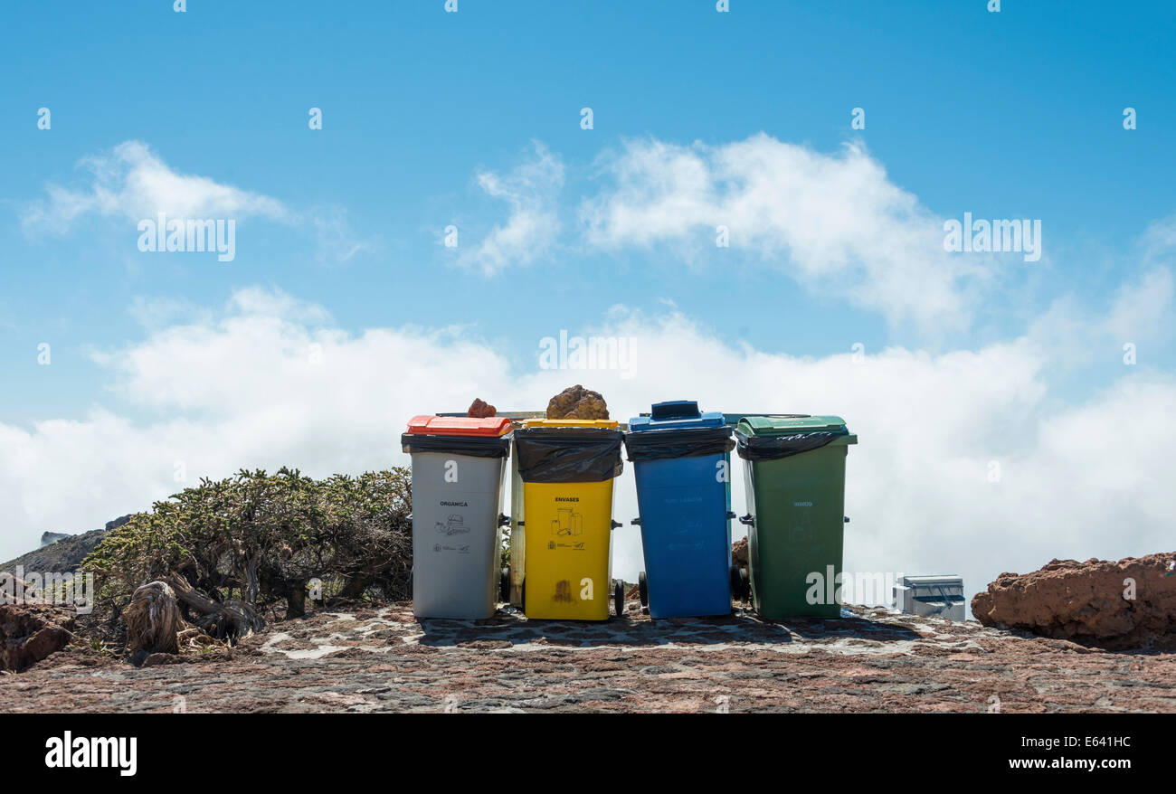 Four rubbish bins against a blue sky, Roque de los Muchachos, La Palma, Canary Islands, Spain - Stock Image