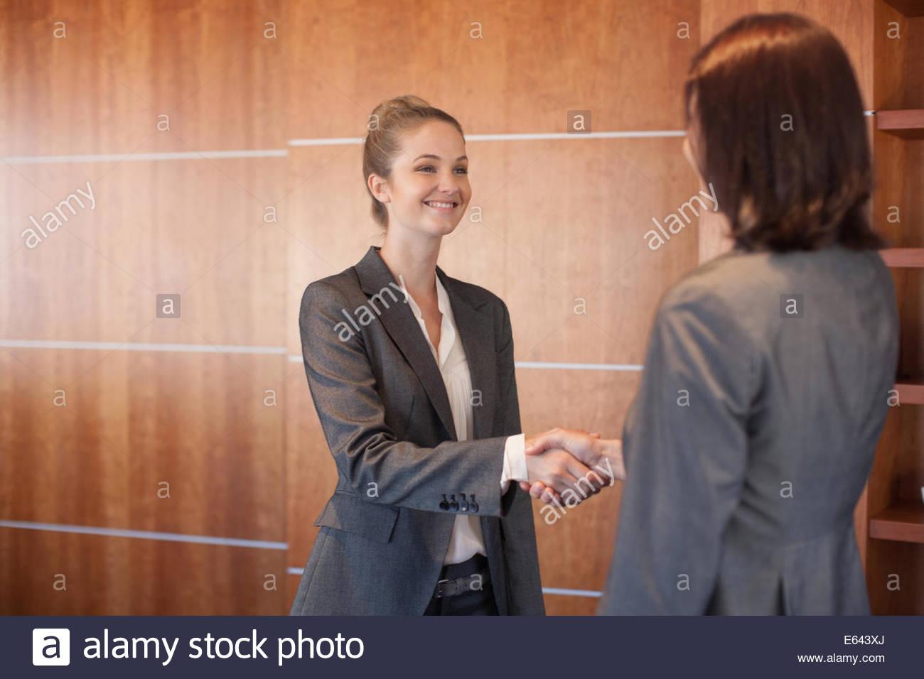 Two businesswomen shaking hands - Stock Image