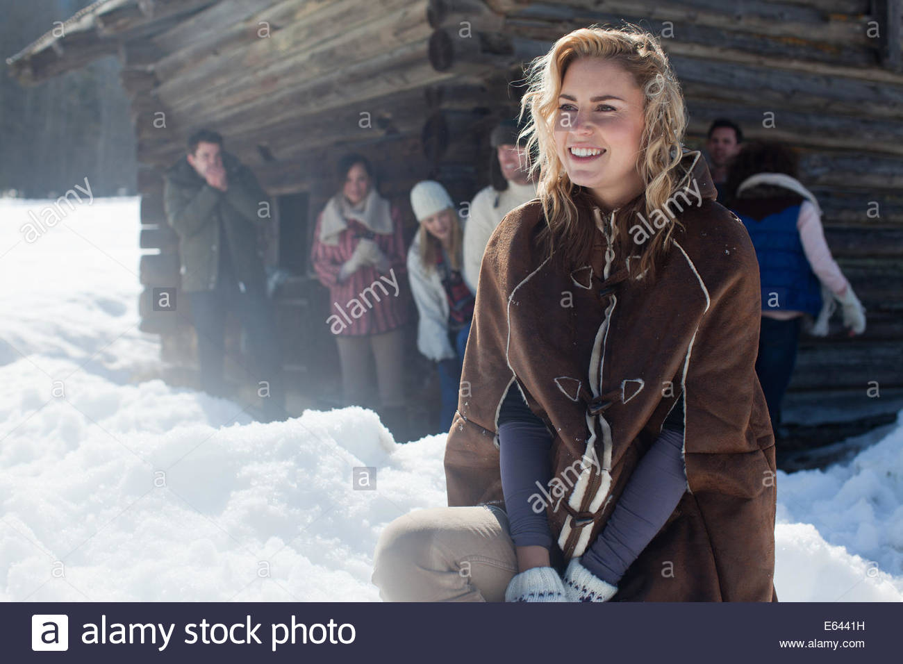 Portrait of smiling woman with friends in background - Stock Image