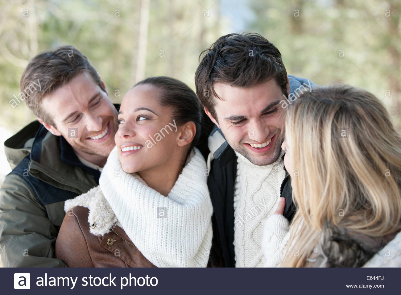 Smiling couples hugging - Stock Image