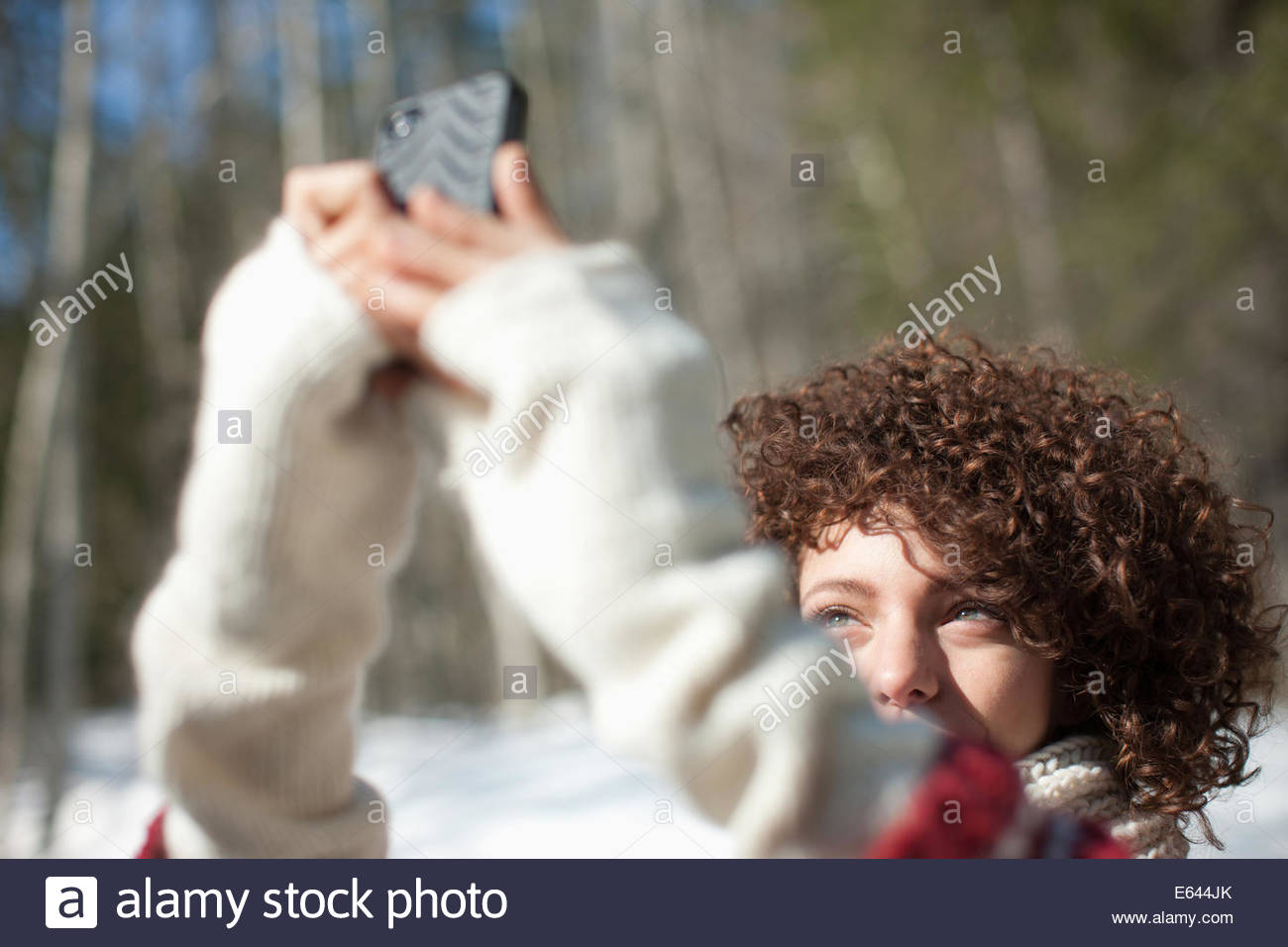 Woman taking photograph with cell phone - Stock Image