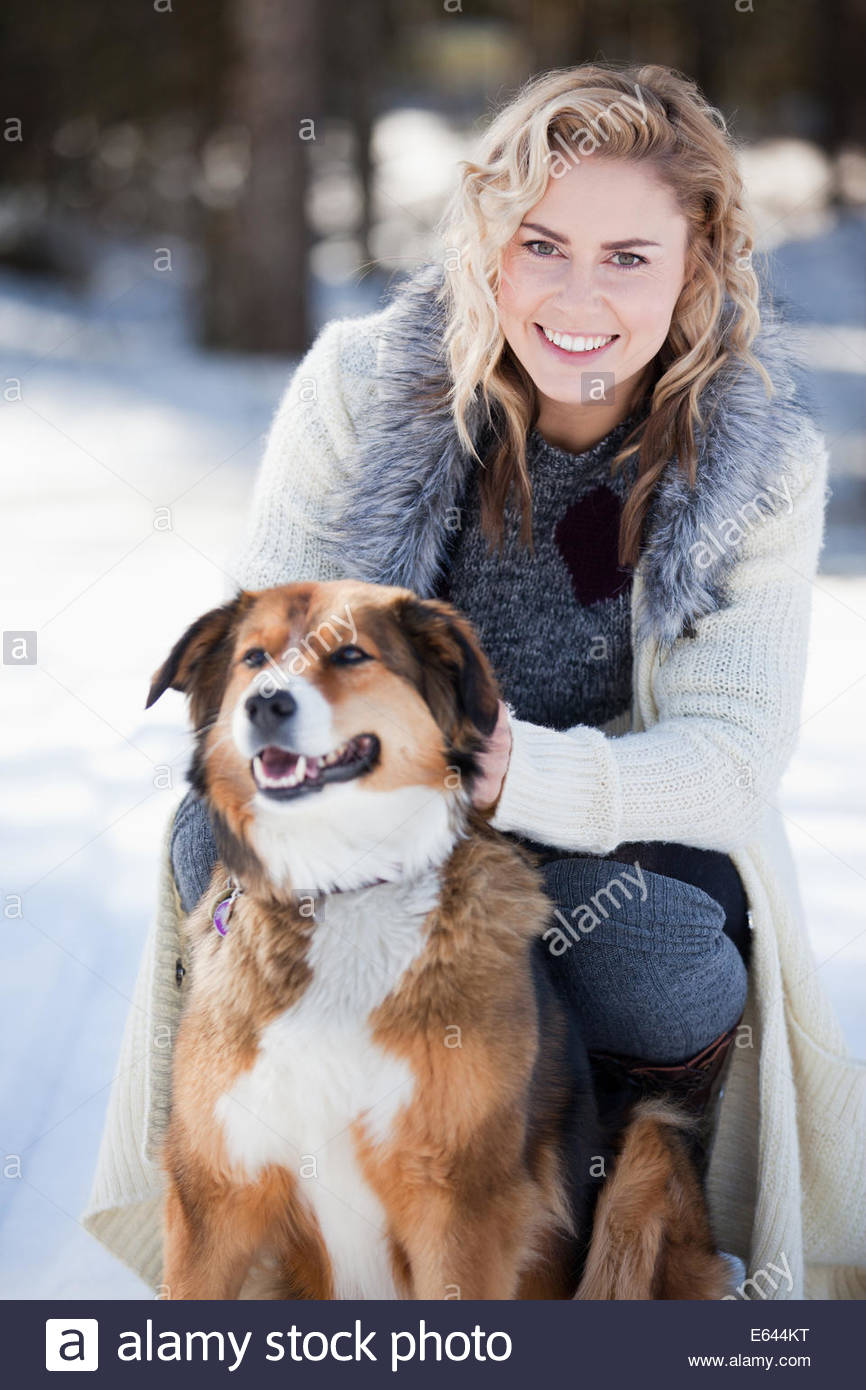 Woman with dog in snow - Stock Image