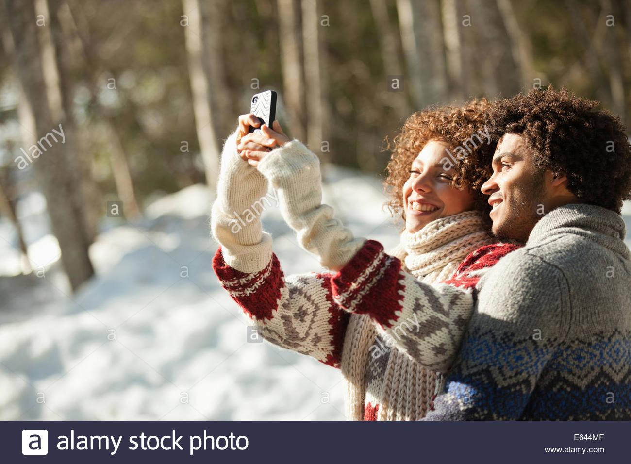 Couple photographing themselves with cell phone - Stock Image