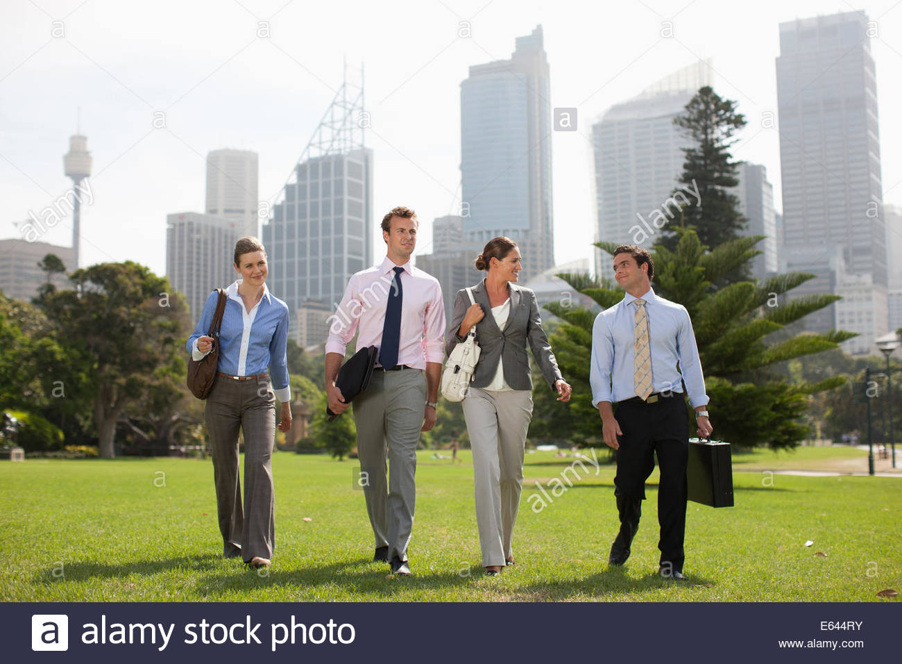 Business people walking together outdoors Stock Photo