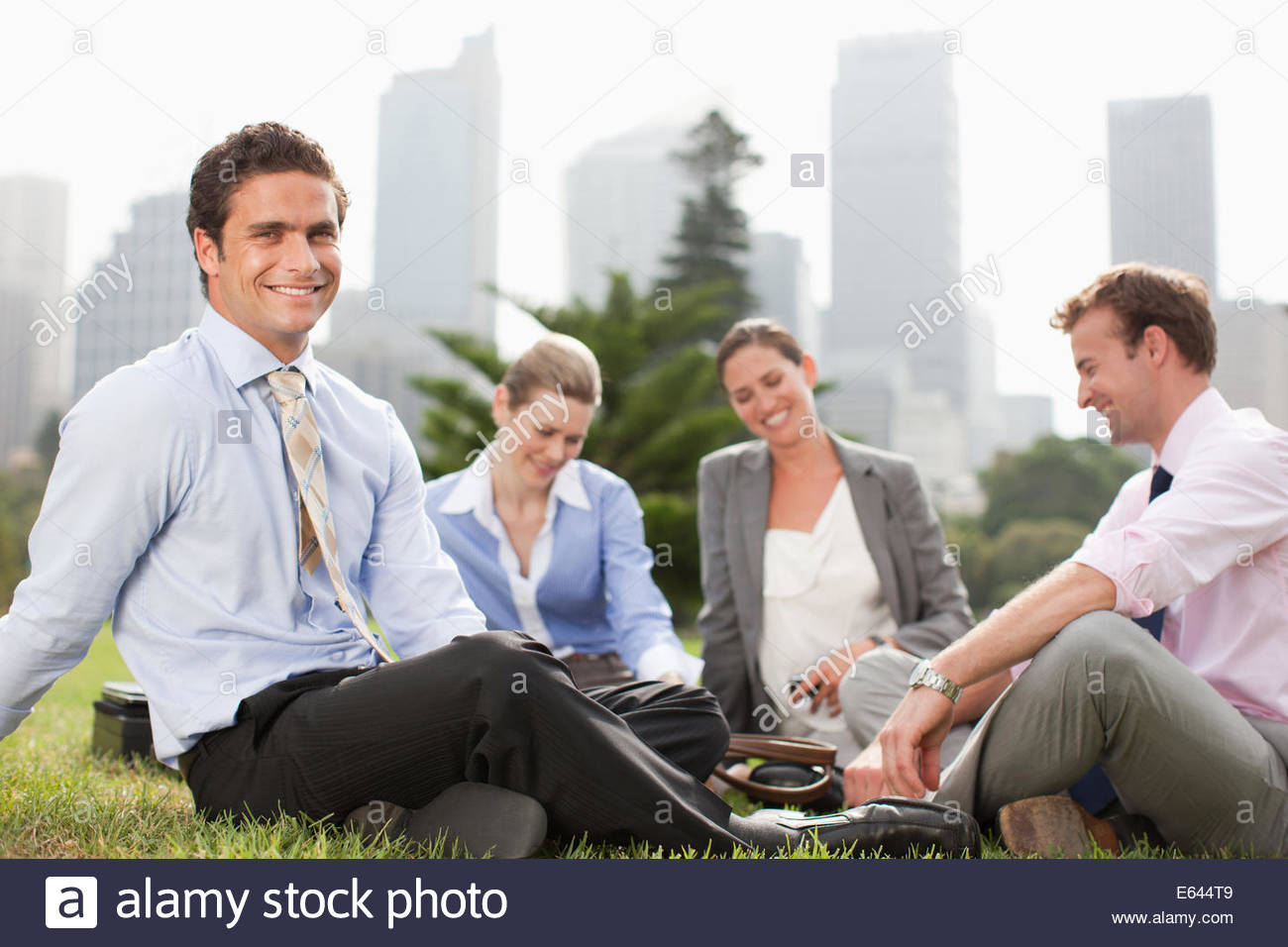 Business people working together in park - Stock Image