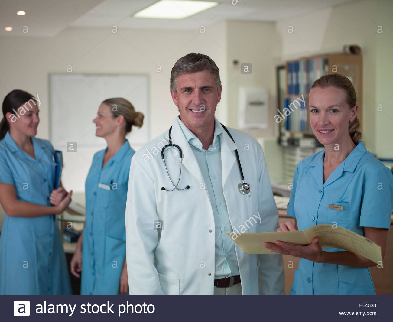 Doctor and nurse reviewing medical chart - Stock Image