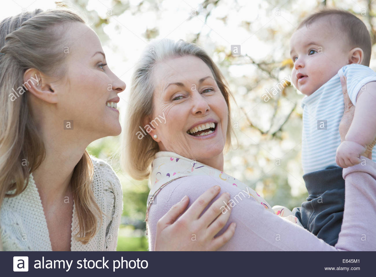 Smiling grandmother, mother and son - Stock Image