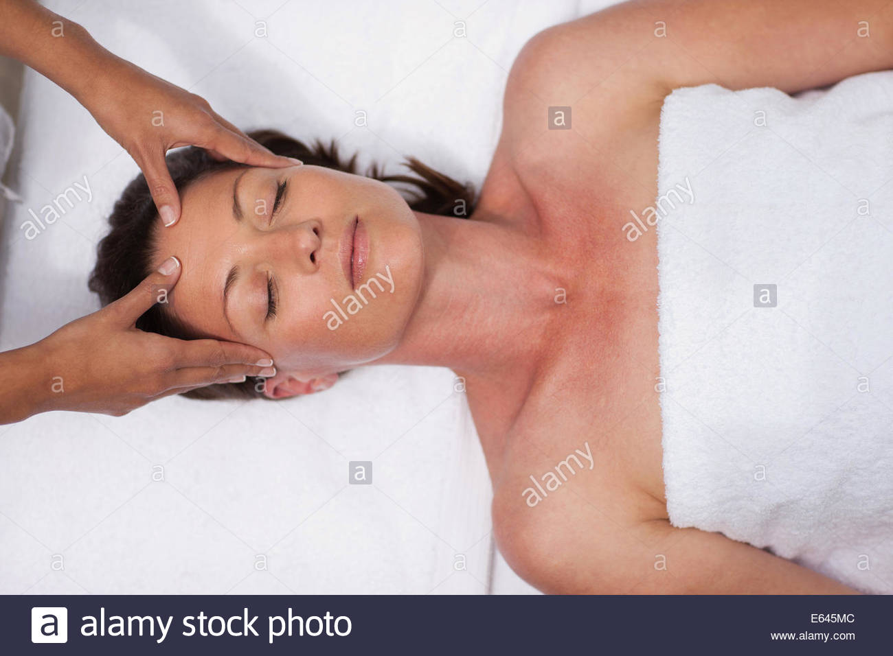 Woman receiving facial massage - Stock Image
