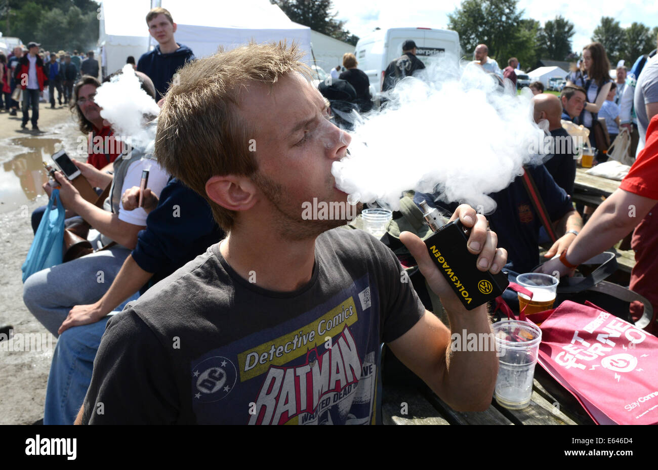 Man exhaling vapour from Volkswagen e cigarette at Vapefest 2014 - Stock Image