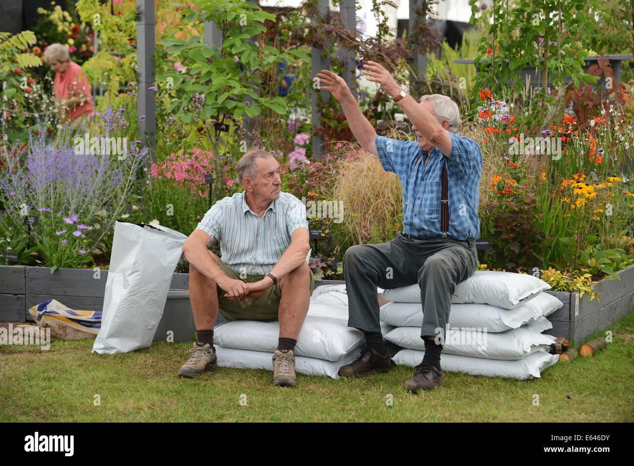 Gardeners exhibitors taking a break and talking at Shrewsbury Flower Show 2014 - Stock Image