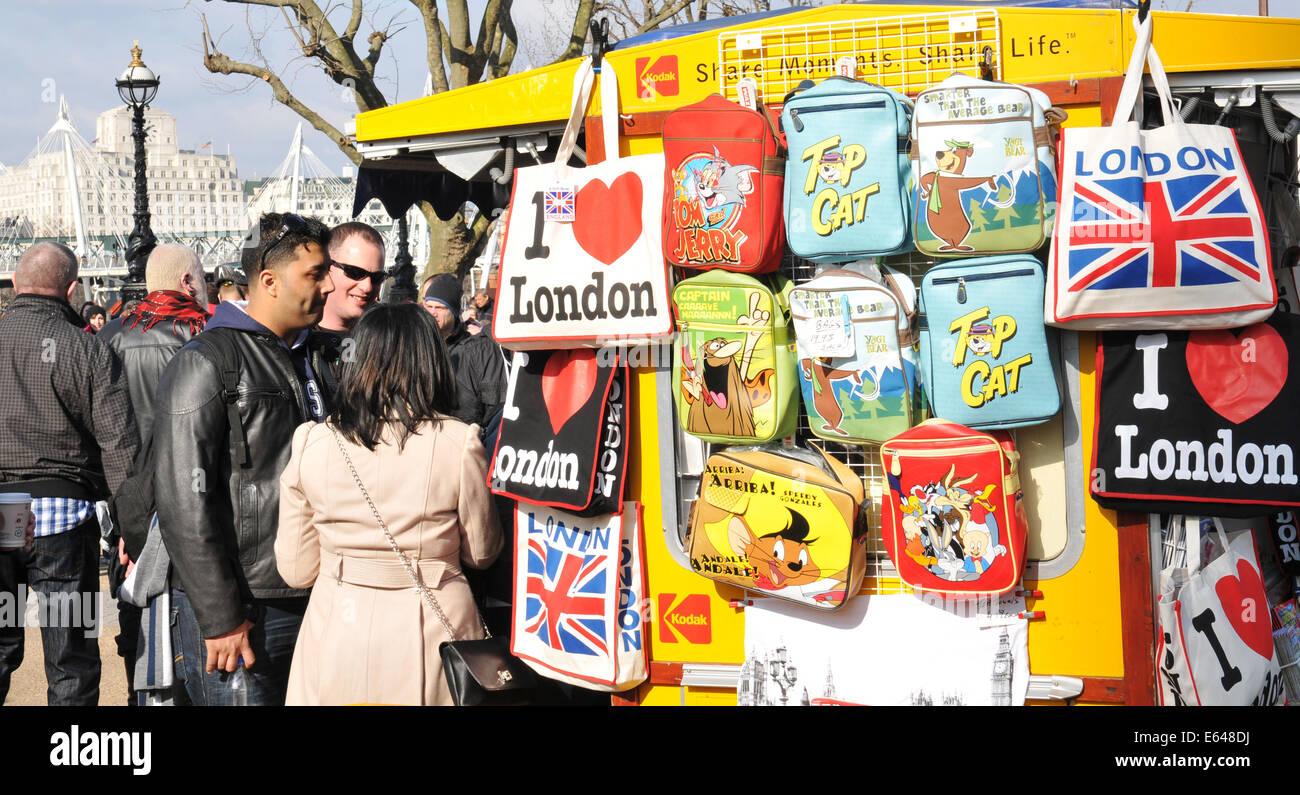 LONDON, UK - MARCH 5, 2011: Tourists buy souvenirs at kiosk near