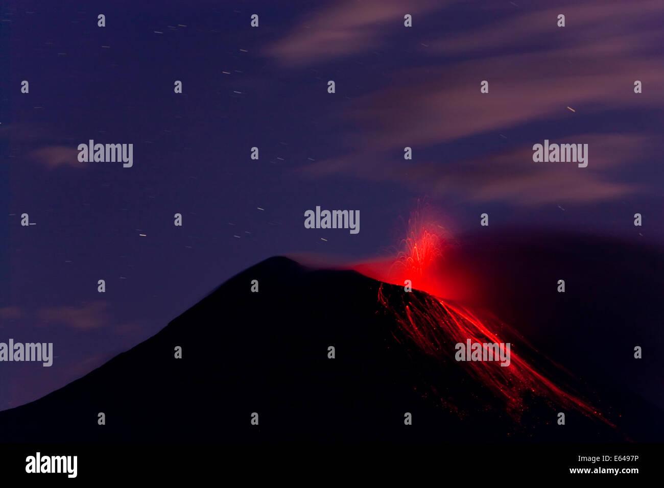 Tungurahua volcano erupting with lava flow, Banos, Ecuador - Stock Image