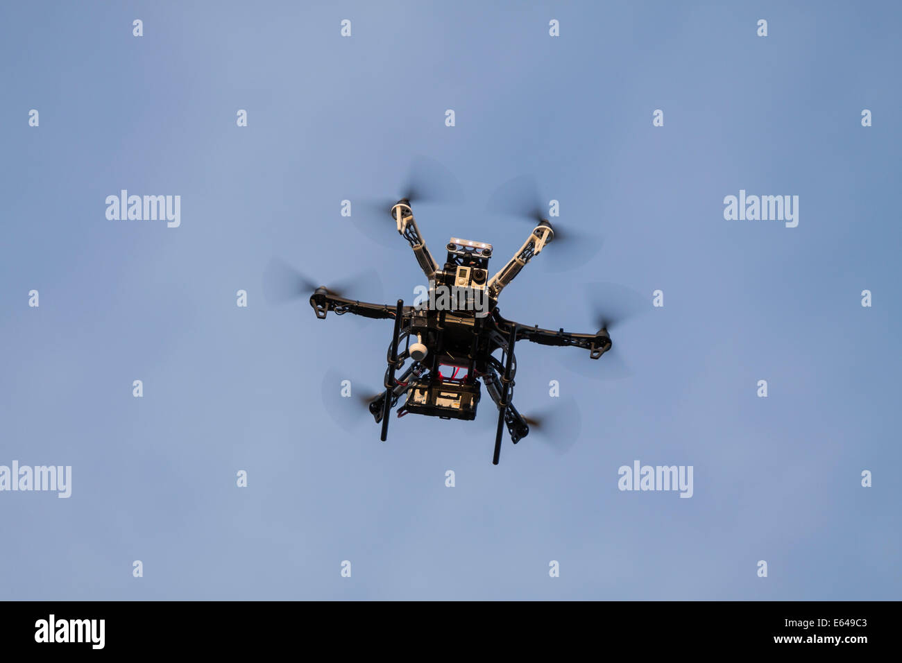 Hexacopter drone with a GoPro Hero camera on board - Stock Image