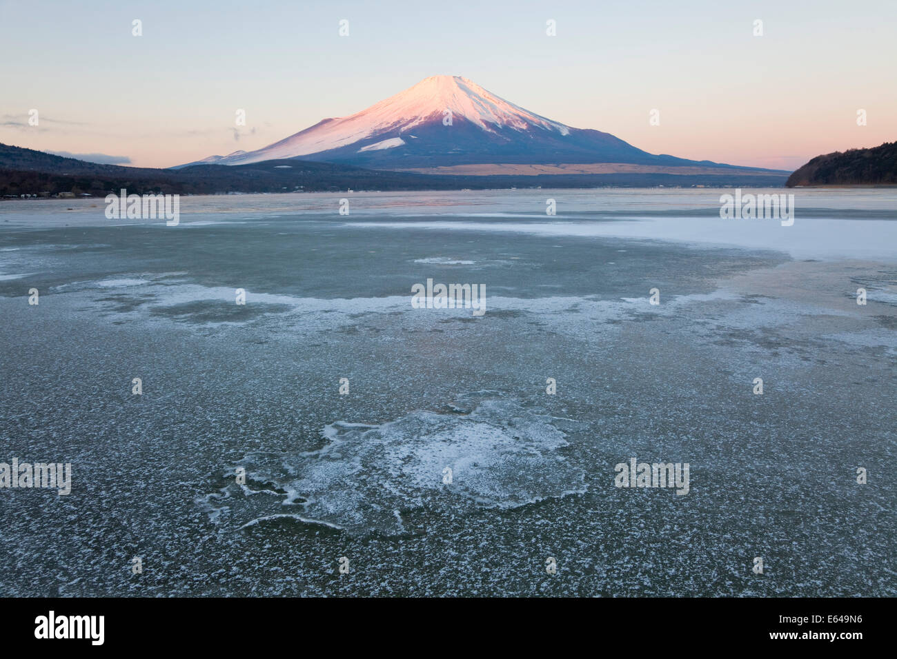 Ice on Lake Yamanaka with snowcovered Mount Fuji in background, Japan - Stock Image