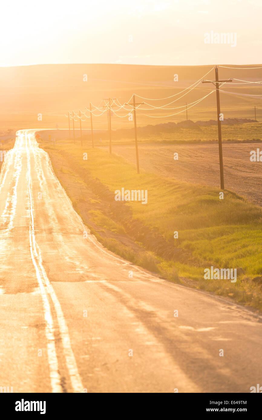 Open road at sunset, Montana, USA Stock Photo