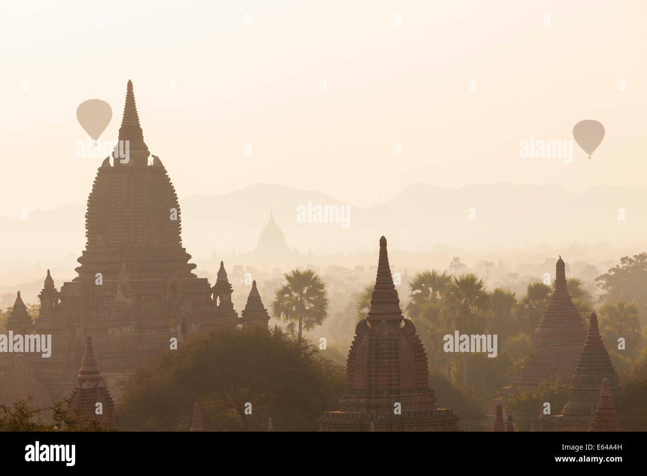 Ancient temple city of Bagan (also Pagan) & balloons at sunrise, Myanmar (Burma) - Stock Image