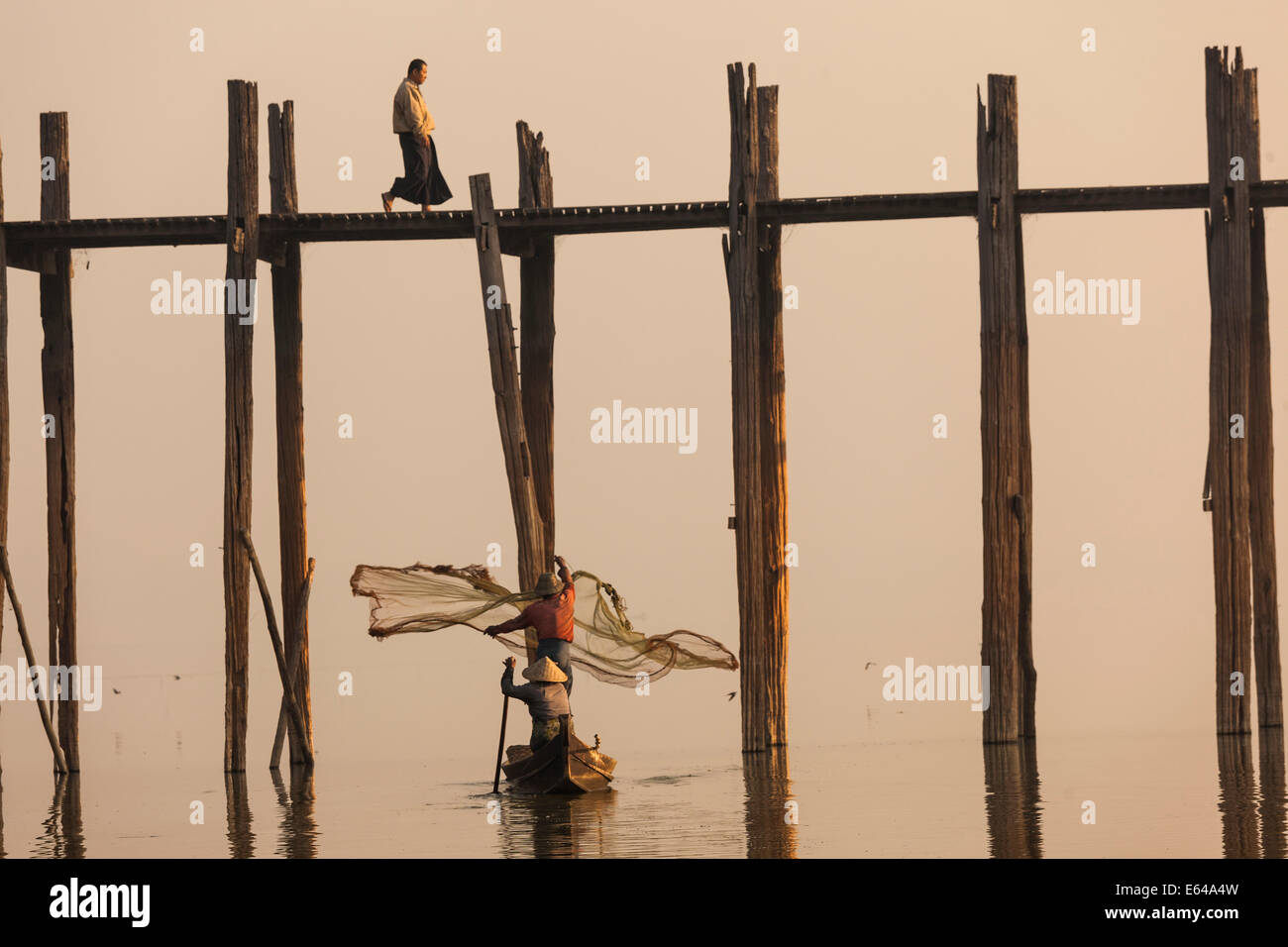 U Bein teak bridge at sunrise, Mandalay, Myanmar - Stock Image
