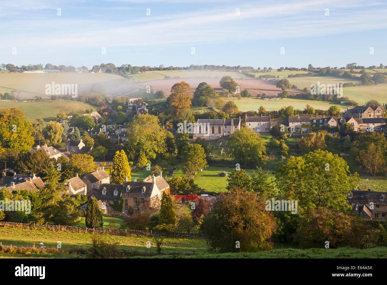 Naunton village and morning mist, Naunton, Gloucestershire, Cotswolds, UK - Stock Image