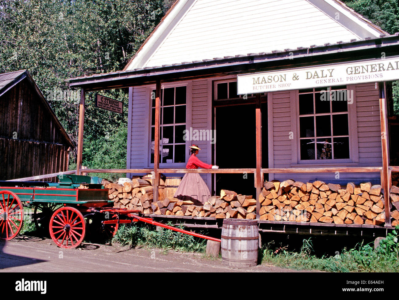 A costumed docent go shopping at the general store,Barkerville,British Columbia - Stock Image