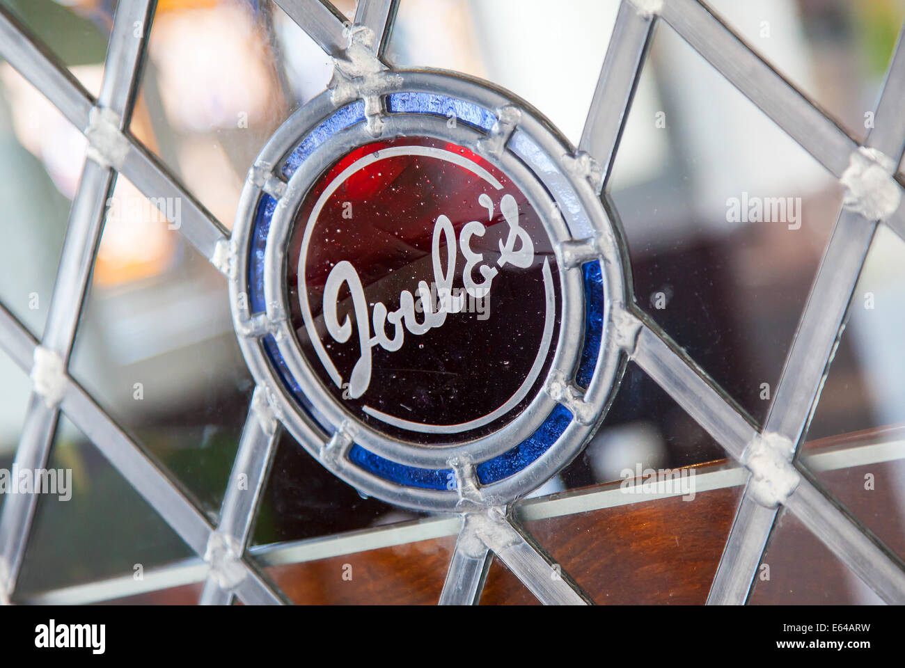 A Joules Brewery name sign embedded in a stained glass window of a pub or public house window at the Royal Oak PH - Stock Image