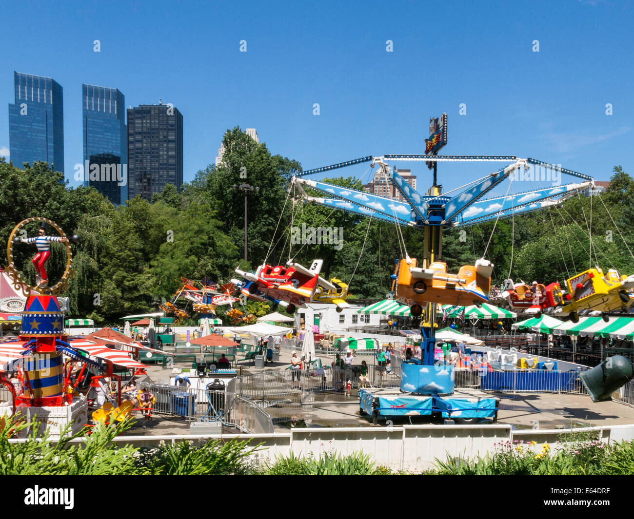 Beau Victorian Gardens, Carnival Rides In Central Park With West Side Skyline In  Background, NYC