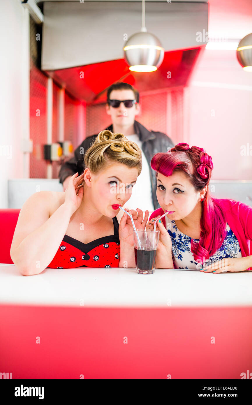 Two women dressed in 1950's style American clothing pin-up