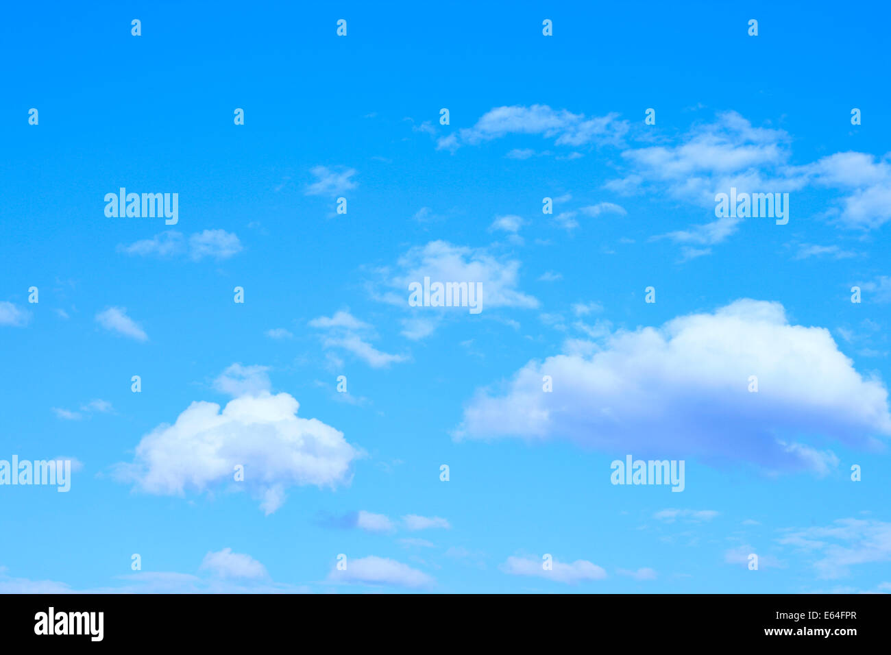 Blue sky and fluffy clouds, may be used as background - Stock Image