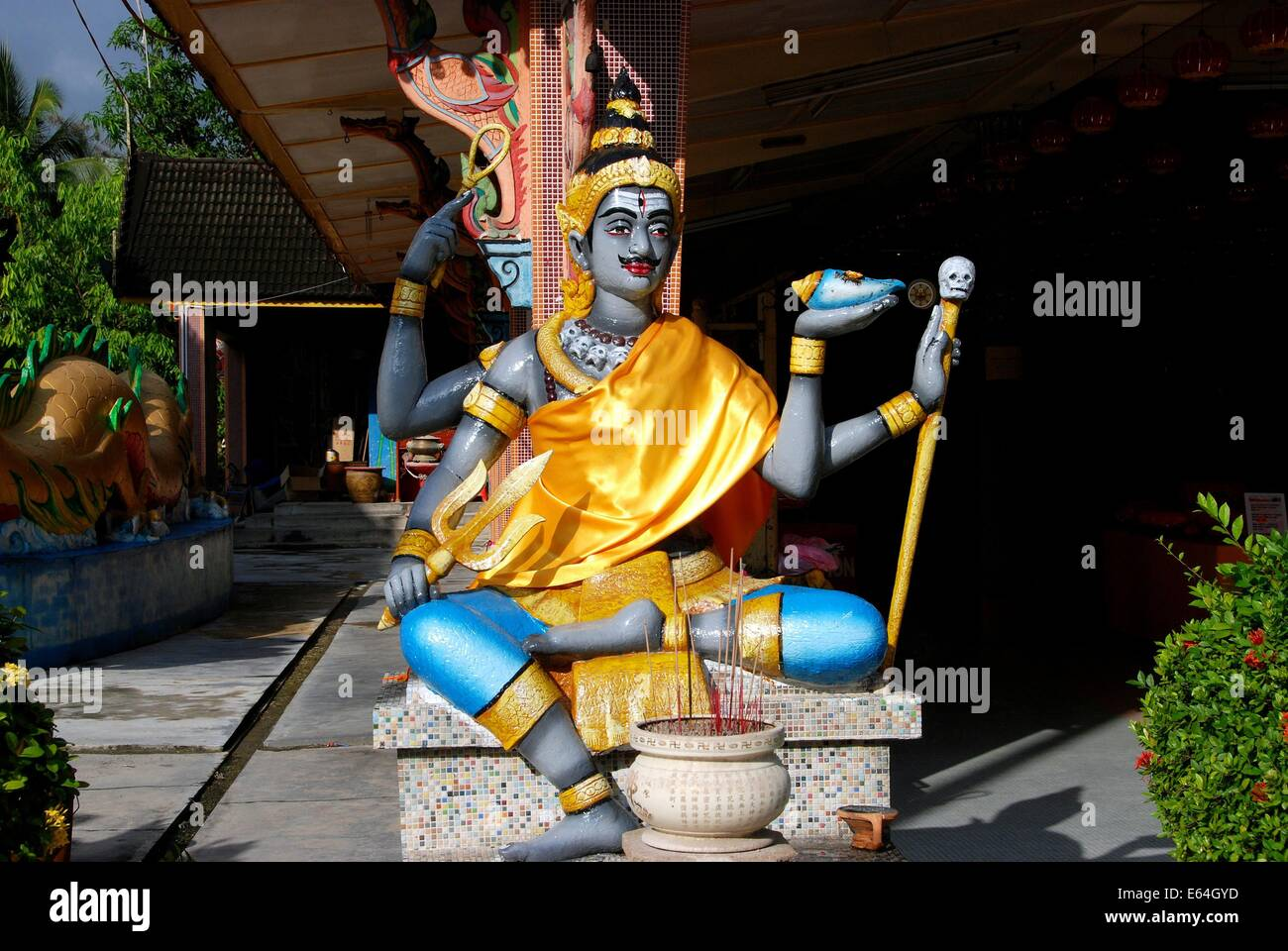 GEORGETOWN, MALAYSIA:   Statue seems more Hindu than Thai seated in front of the prayer hall at Thai Wat Buppharam Stock Photo