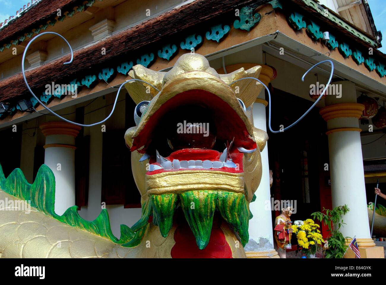 GEORGETOWN, MALAYSIA: Closeup of the immense dragon with its open mouth holding a symbolic ball at Thai Wat Buppharam Stock Photo