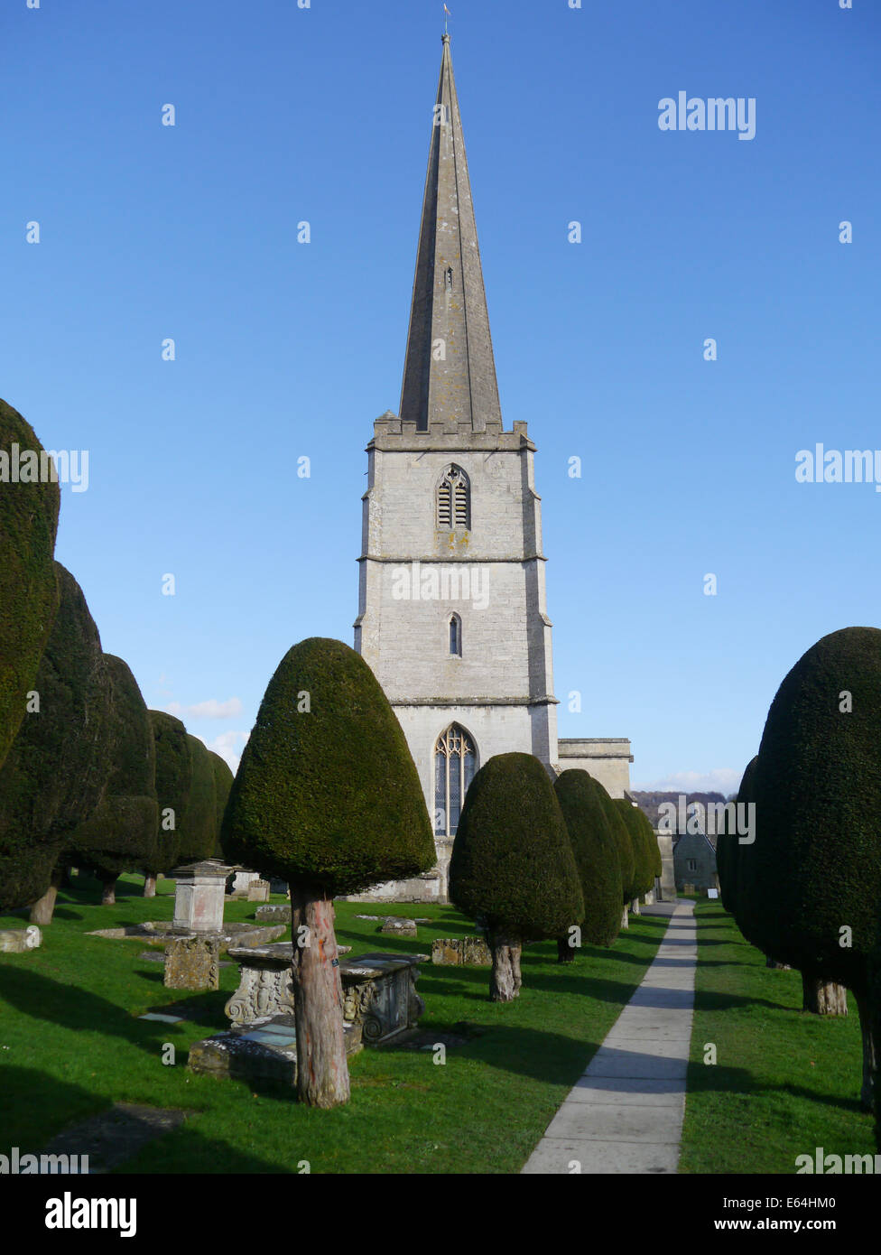 St Marys Parish Church,famous for its Yew Trees. In the Cotswolds Village of Painswick, Gloucestershire,England. - Stock Image