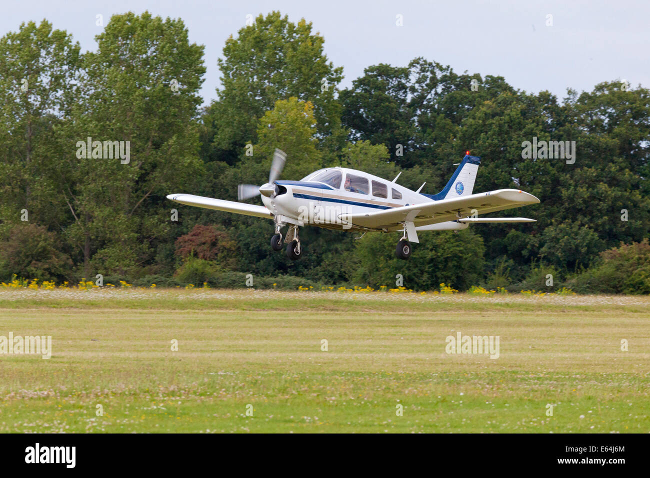 PIPER PA-28R-200 CHEROKEE ARROW light aircraft taking off in UK - Stock Image