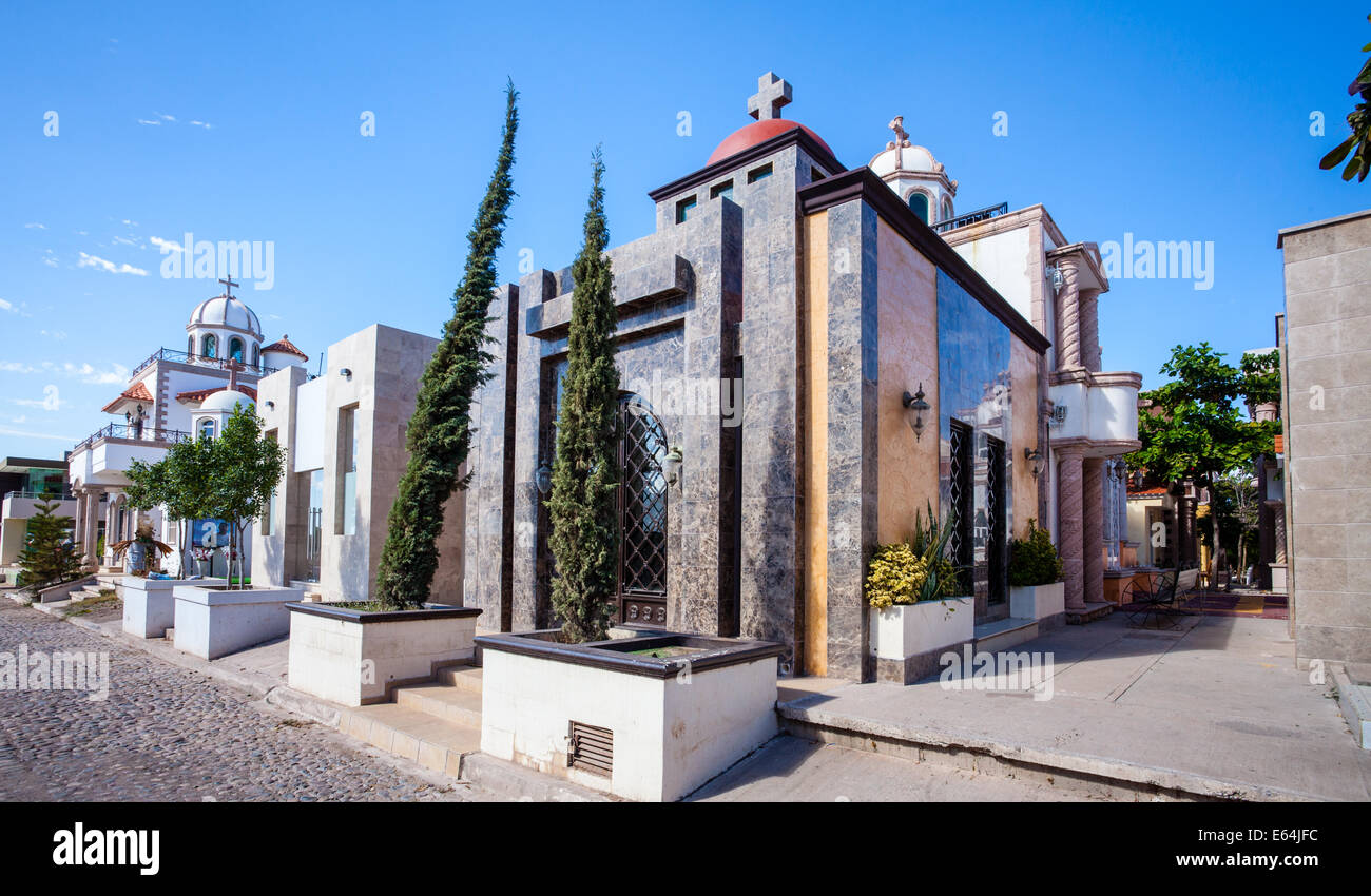 The luxurious mausoleum Jardines de Humaya, final resting place of narco drug lords, looks more like an upscale - Stock Image