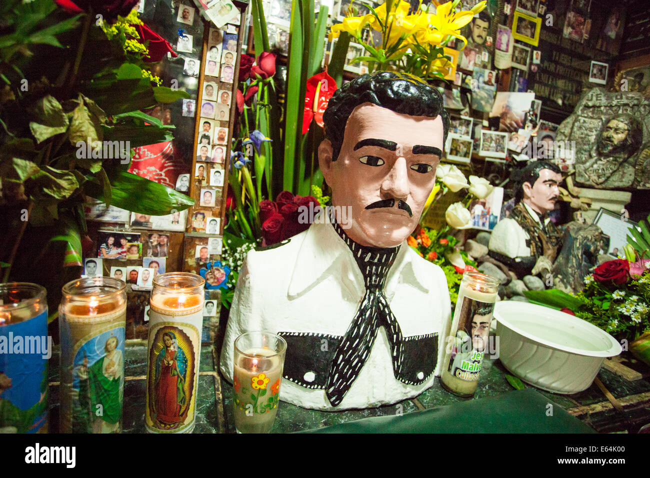 Votive candles at a shrine dedicated to Jesus Malverde, the patron saint of the illegal drug trade, in Culiacan, - Stock Image