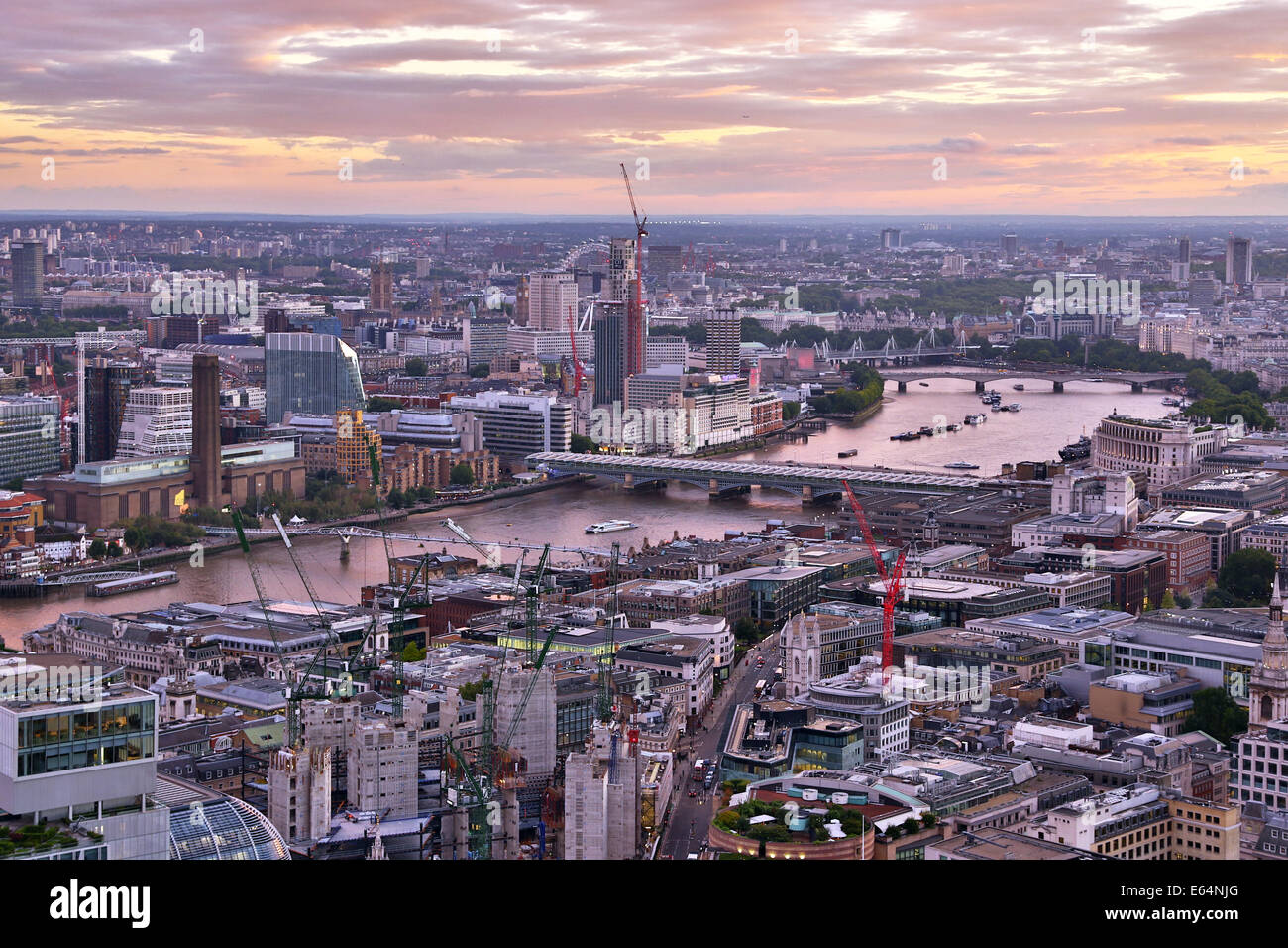 General view of buildings of the city skyline at dusk in London, England Stock Photo