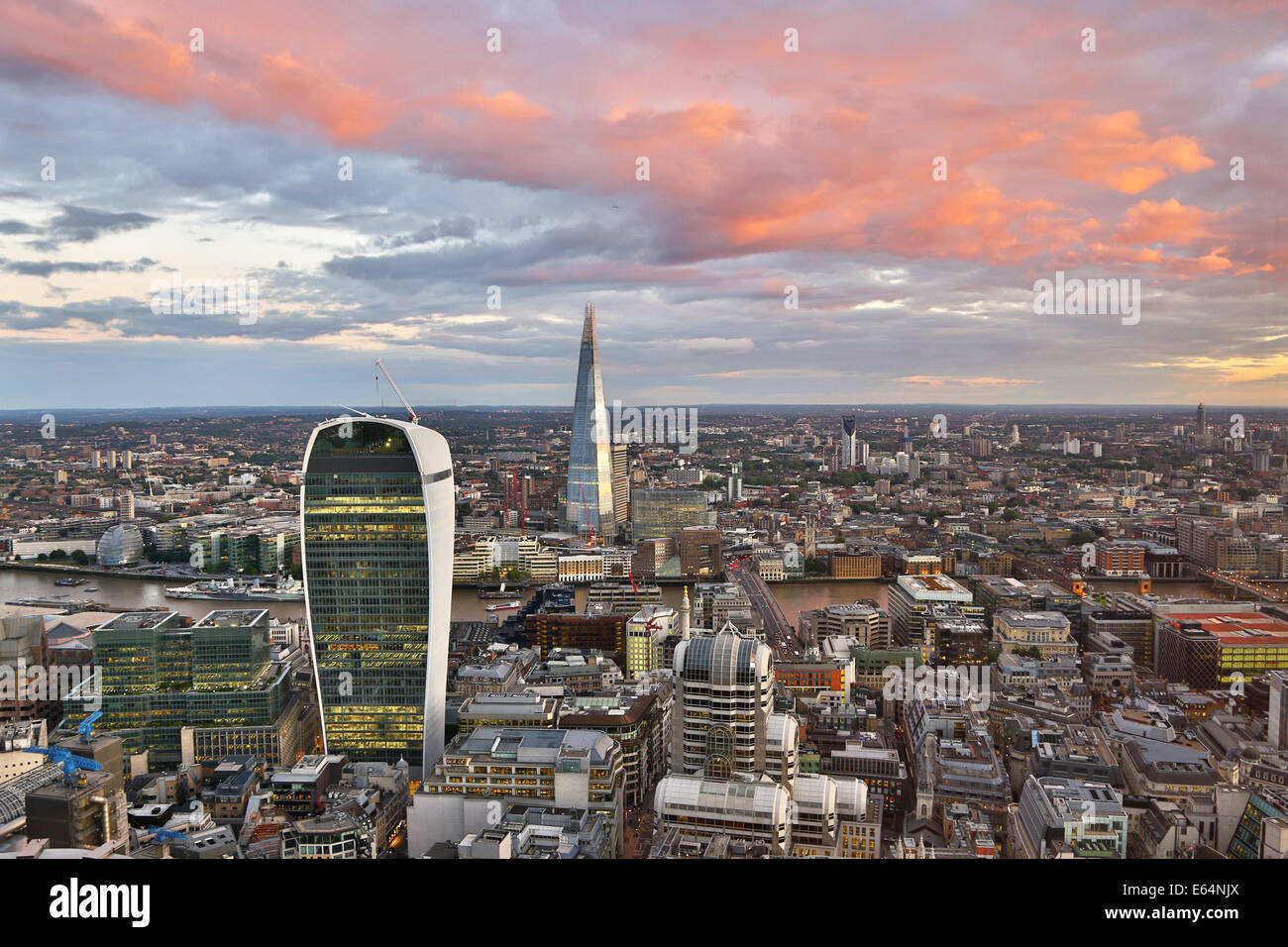 General view of buildings of the city skyline at dusk in London, England - Stock Image