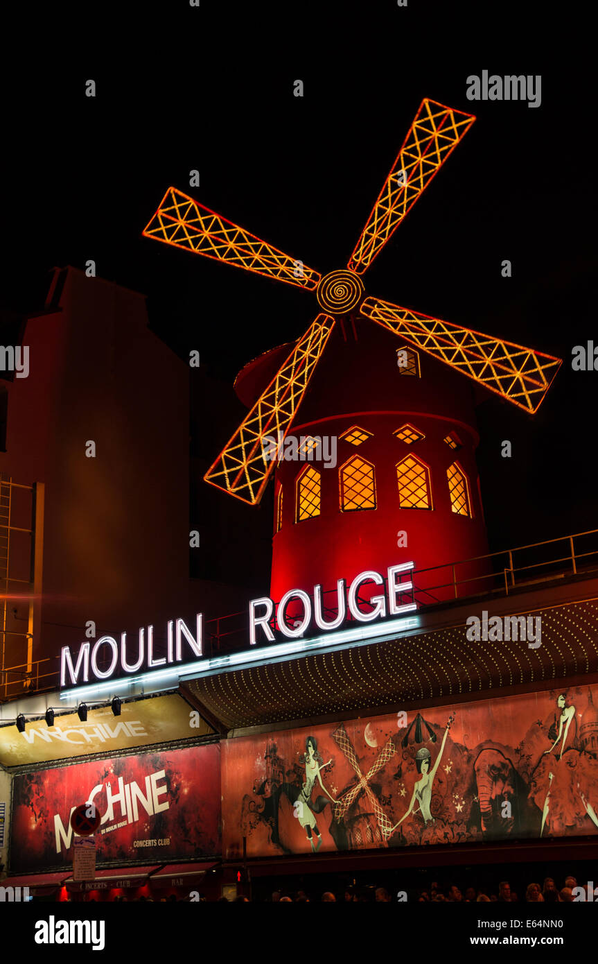 The Moulin Rouge by night in Paris, France - Stock Image