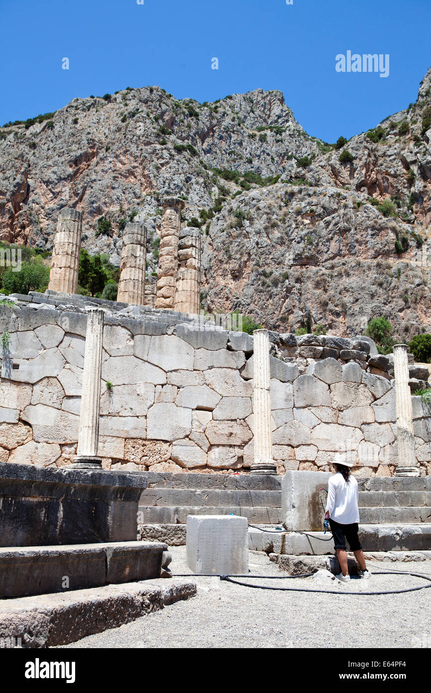 Delphi, Greece, an Archaeologist restoring the ruins - Stock Image