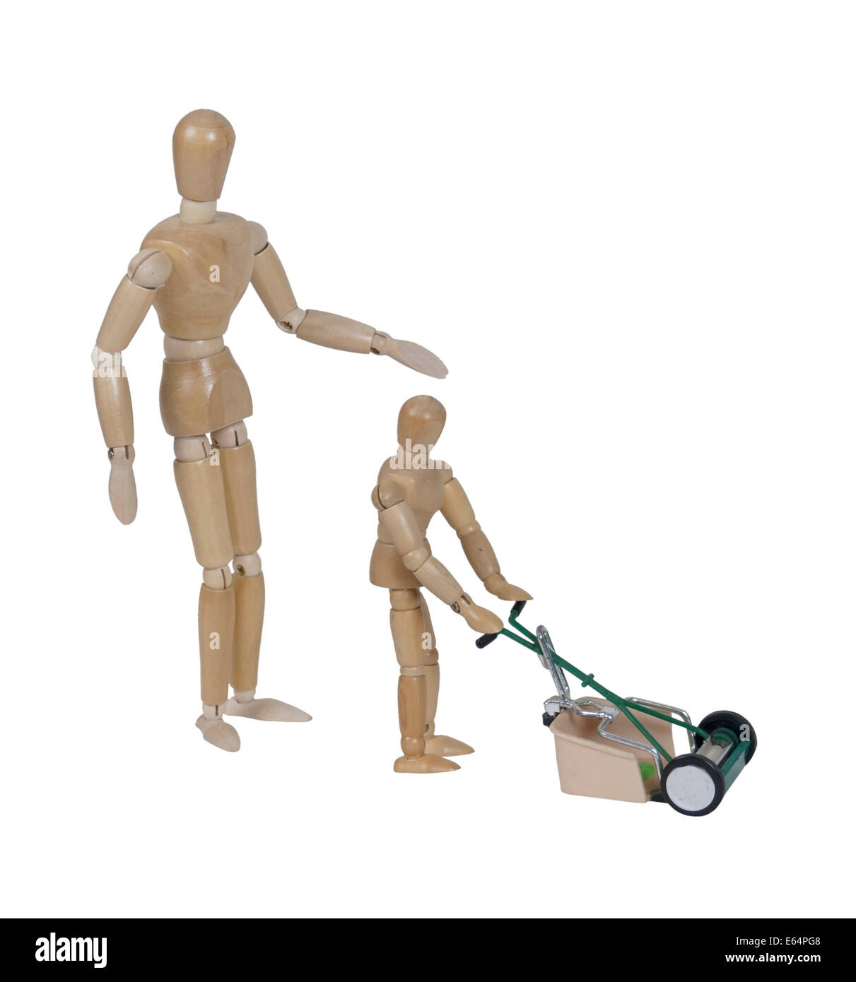 Adult supervising child using a push style lawn mower for cutting the grass - Stock Image