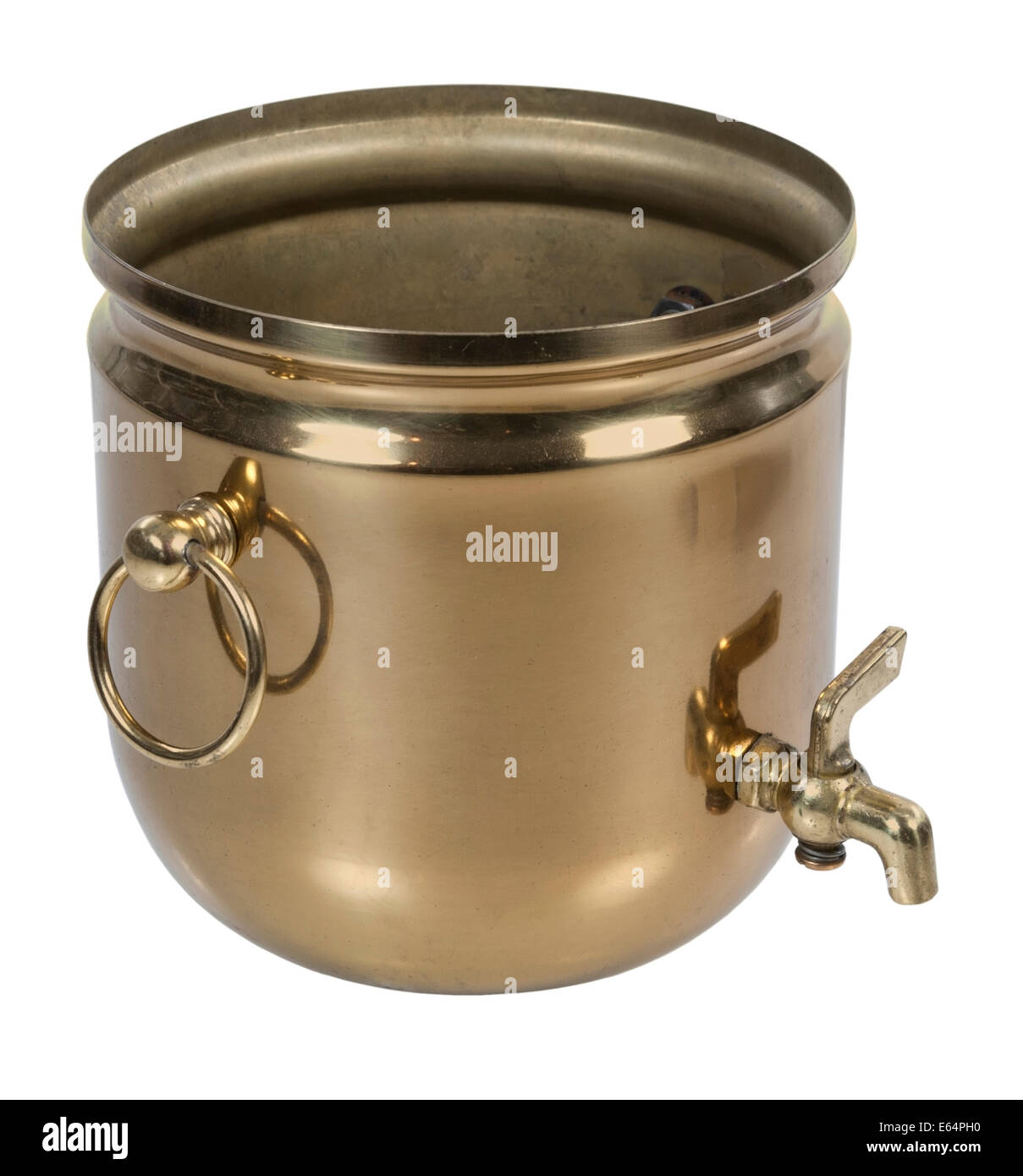 Brass bucket with spigot for carrying and pouring water - path included - Stock Image