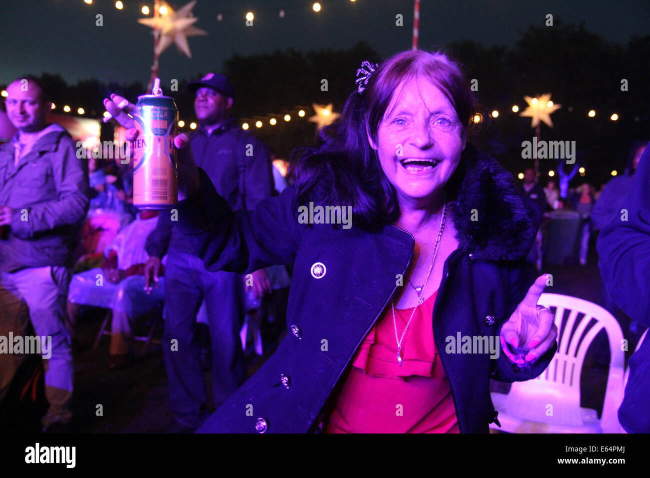 A 70 year old Newham resident dances to  'Lost in Music' at the annual music event. Credit: David Mbiyu/ - Stock Image