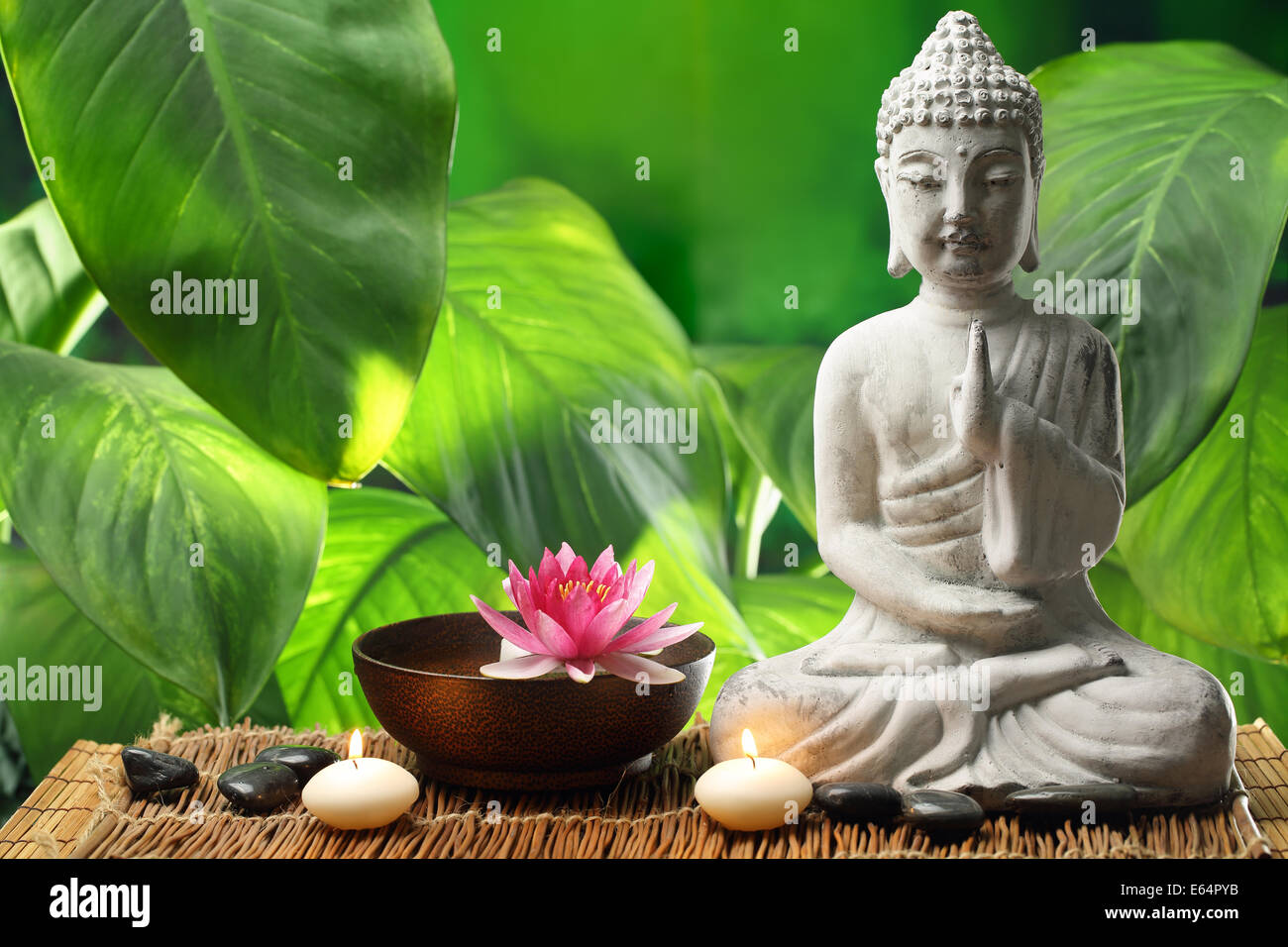 Buddha In Meditation With Lotus Flower And Burning Candles Stock