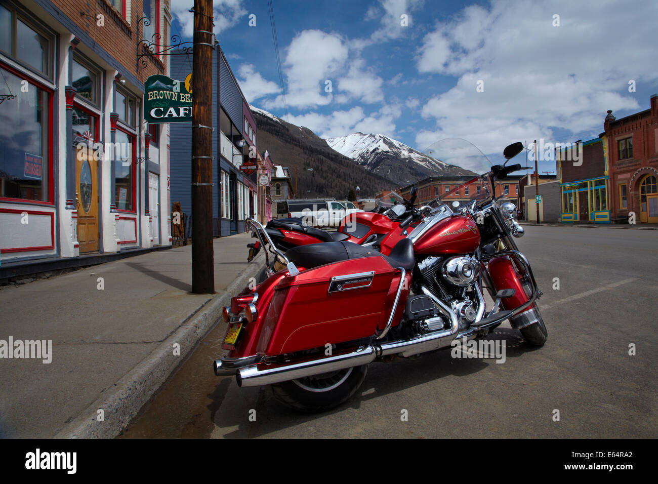Motorcycles and the historic mining town of Silverton, San Juan Mountains, Colorado, USA - Stock Image