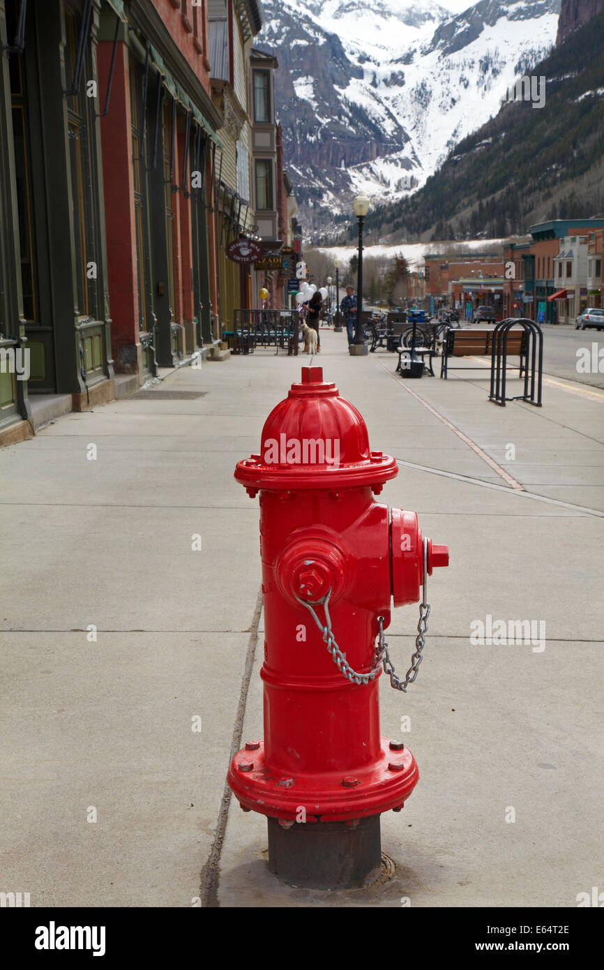 Red fire hydrant at Telluride, historic mining town and ski resort, San Juan Mountains, San Miguel County, Colorado, - Stock Image