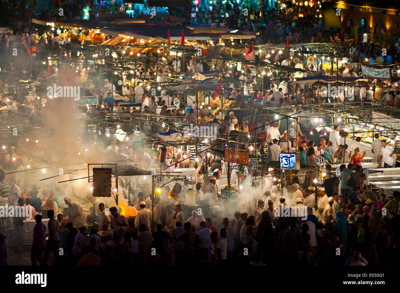 Food stalls in Djemaa el Fna square at night, Marrakech, Morocco - Stock Image