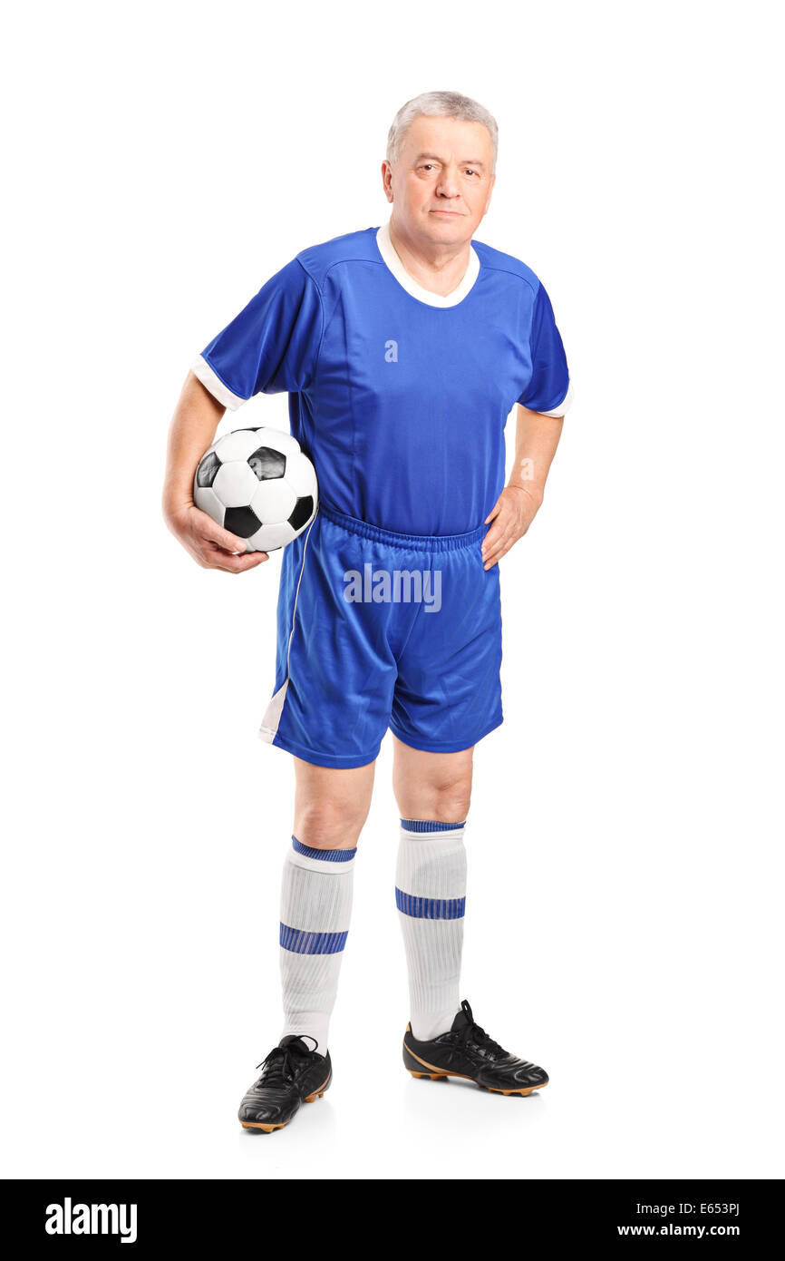 9999b2067 Full length portrait of a mature man in sportswear holding a football -  Stock Image