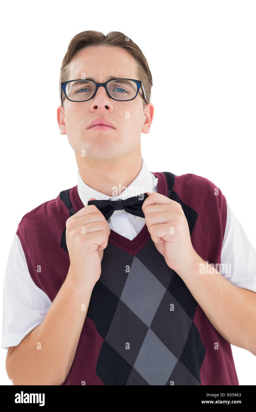 Nerdy hipster fixing his bow tie - Stock Image