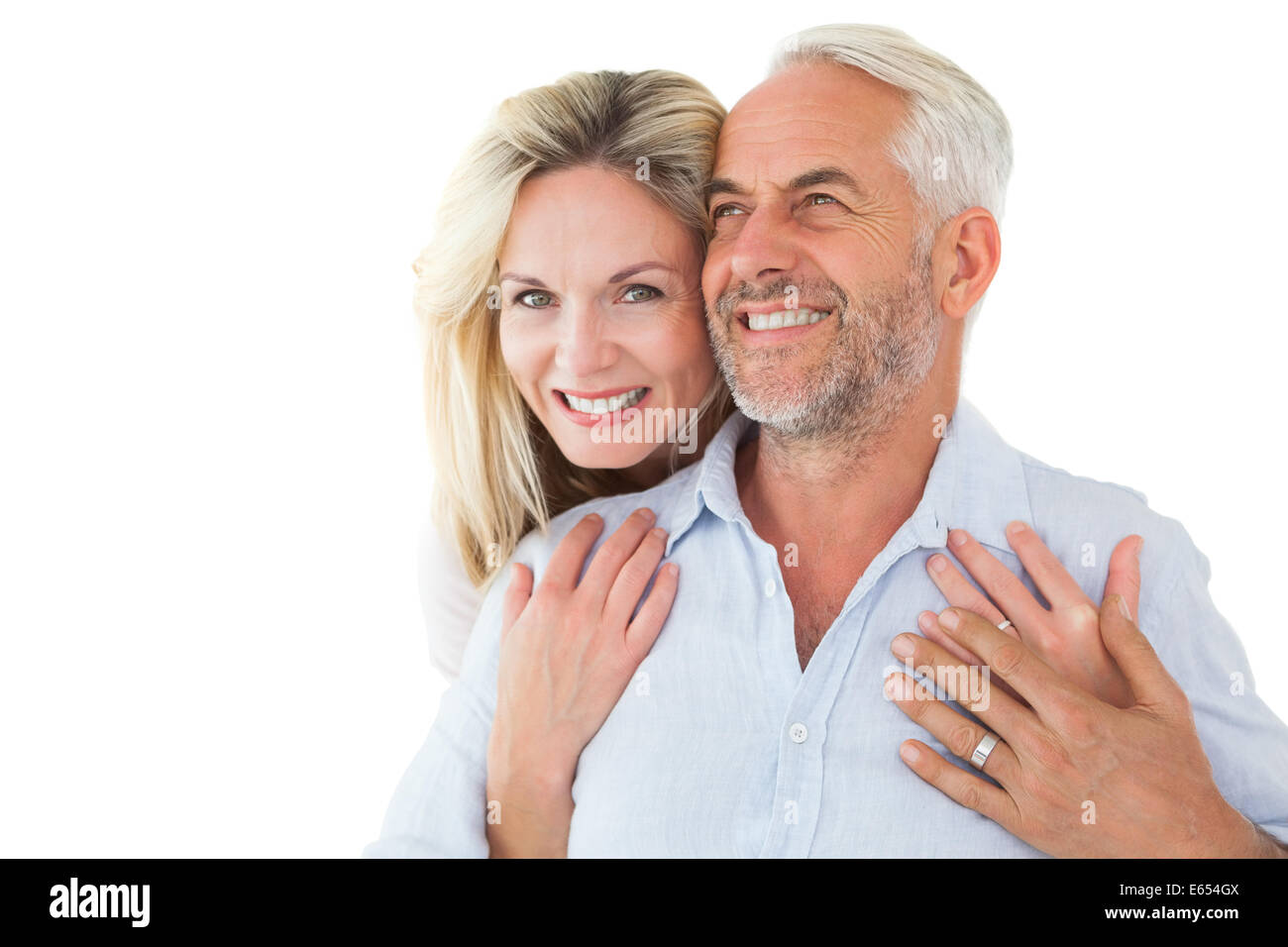 Smiling couple embracing with woman looking at camera Stock Photo